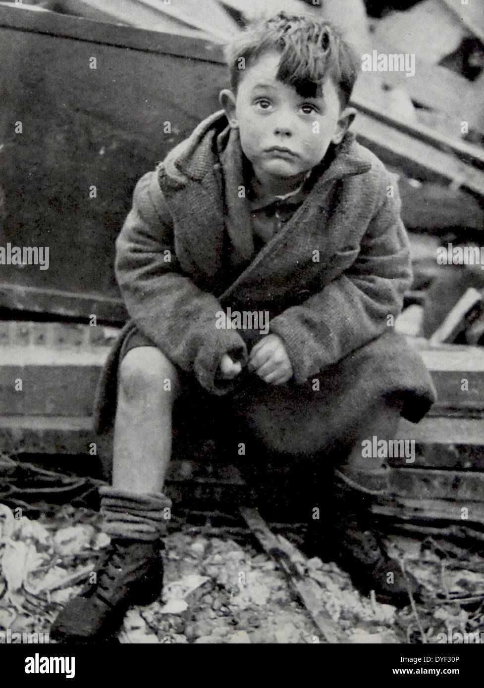 An orphaned child after surviving the Blitz on London. Stock Photo