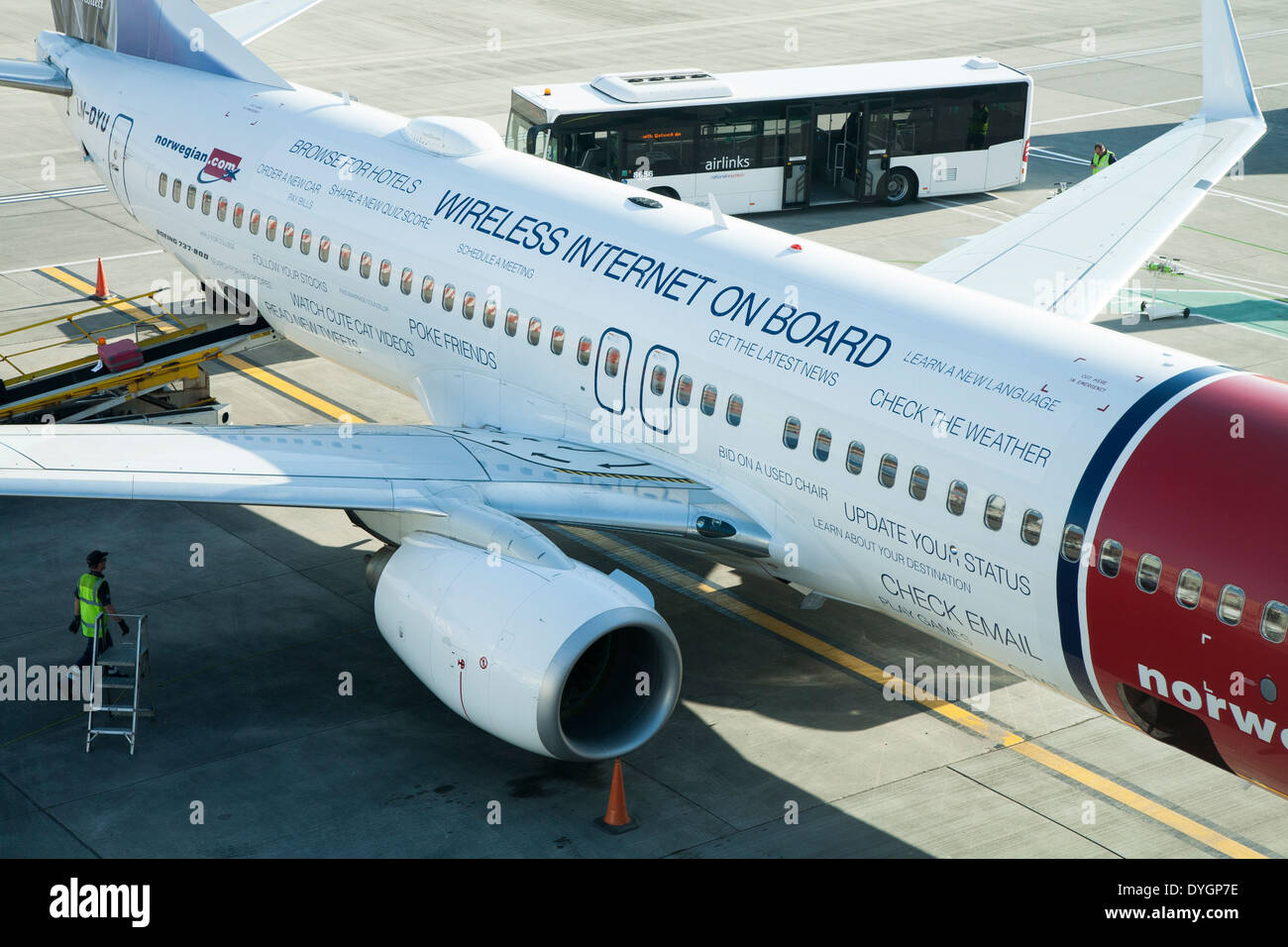 Norwegian.com airplane / plane painted to promote / advertise FREE mobile internet WIFI for passengers on the aircraft - Stock Image