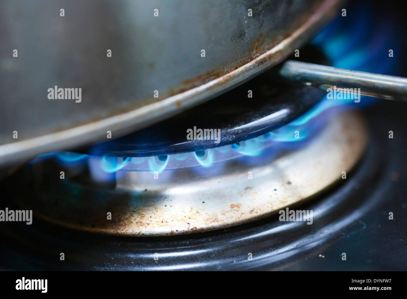 Burning Gas; Cooker; UK - Stock Image