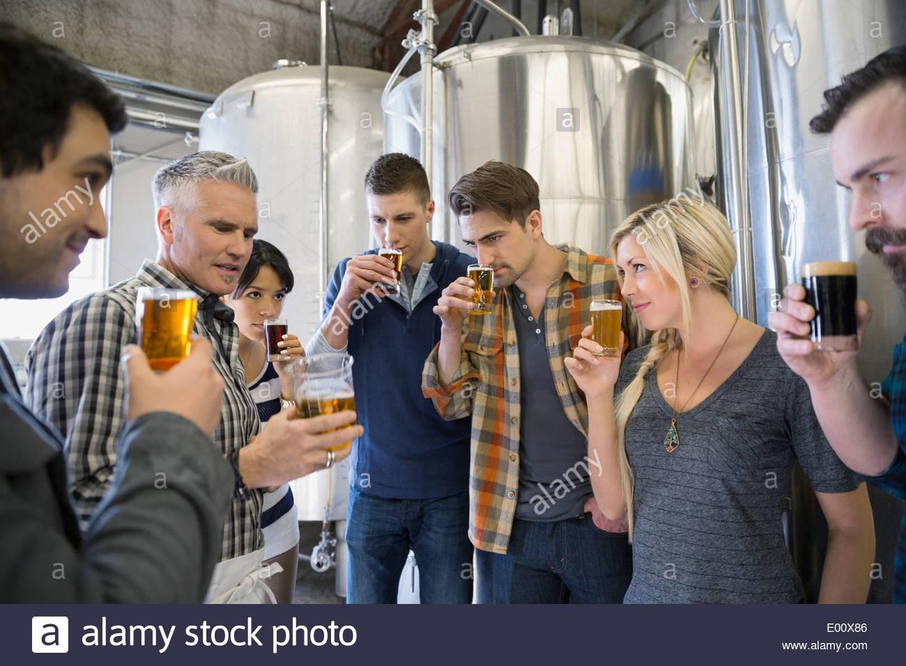 Friends beer tasting at brewery - Stock Image