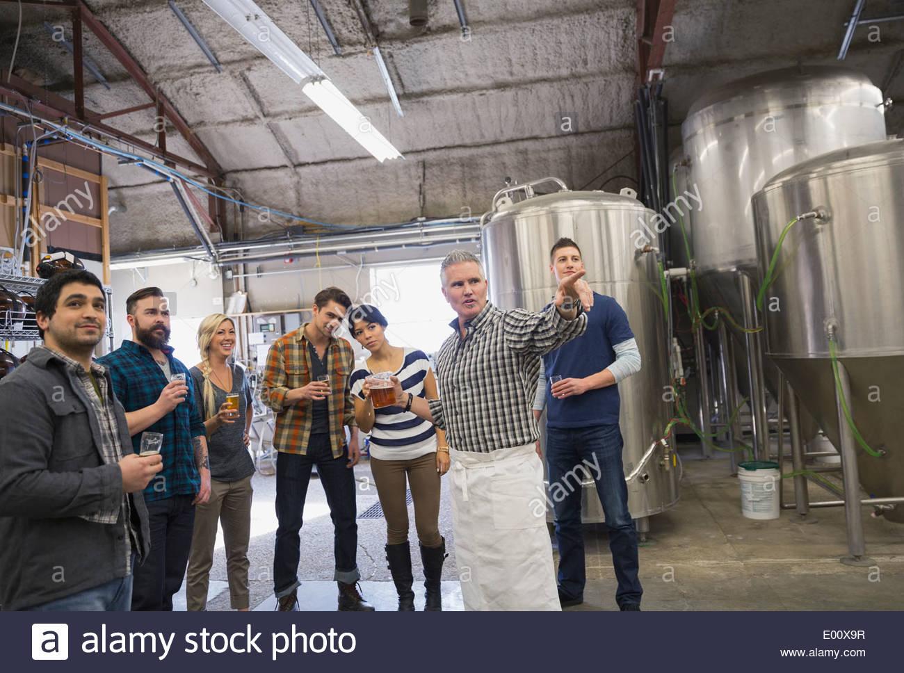 Man guiding tour at brewery - Stock Image