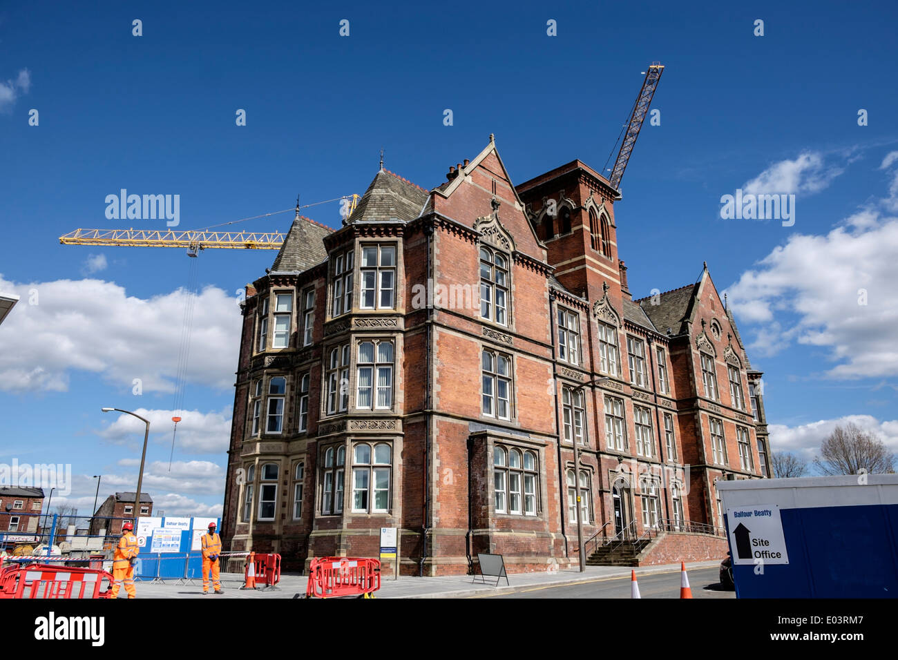 Original Victorian Wing of the Jessop Hospital with construction workers in foreground Sheffield South Yorkshire - Stock Image