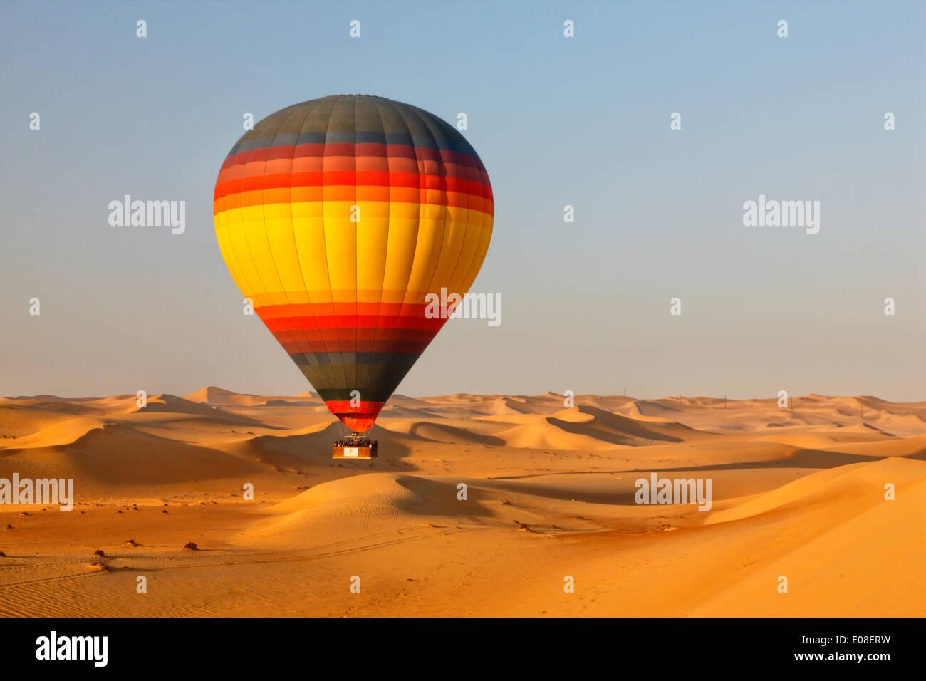 Fly over Dubai desert with hot air balloon - Stock Image