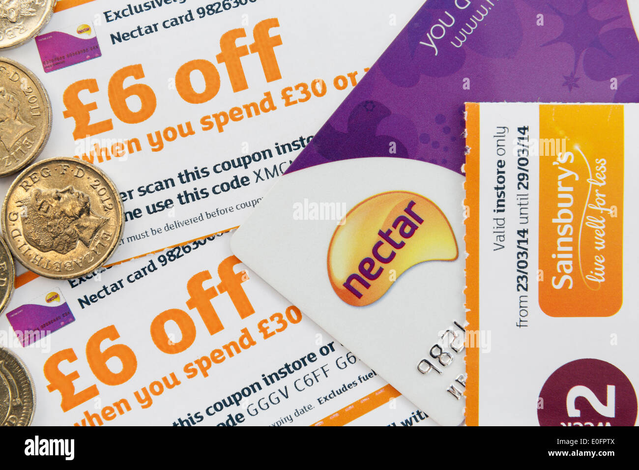 Nectar card and pound coins with £6 money off coupons to save when spending in a Sainsbury's supermarket store.ValueStock Photo