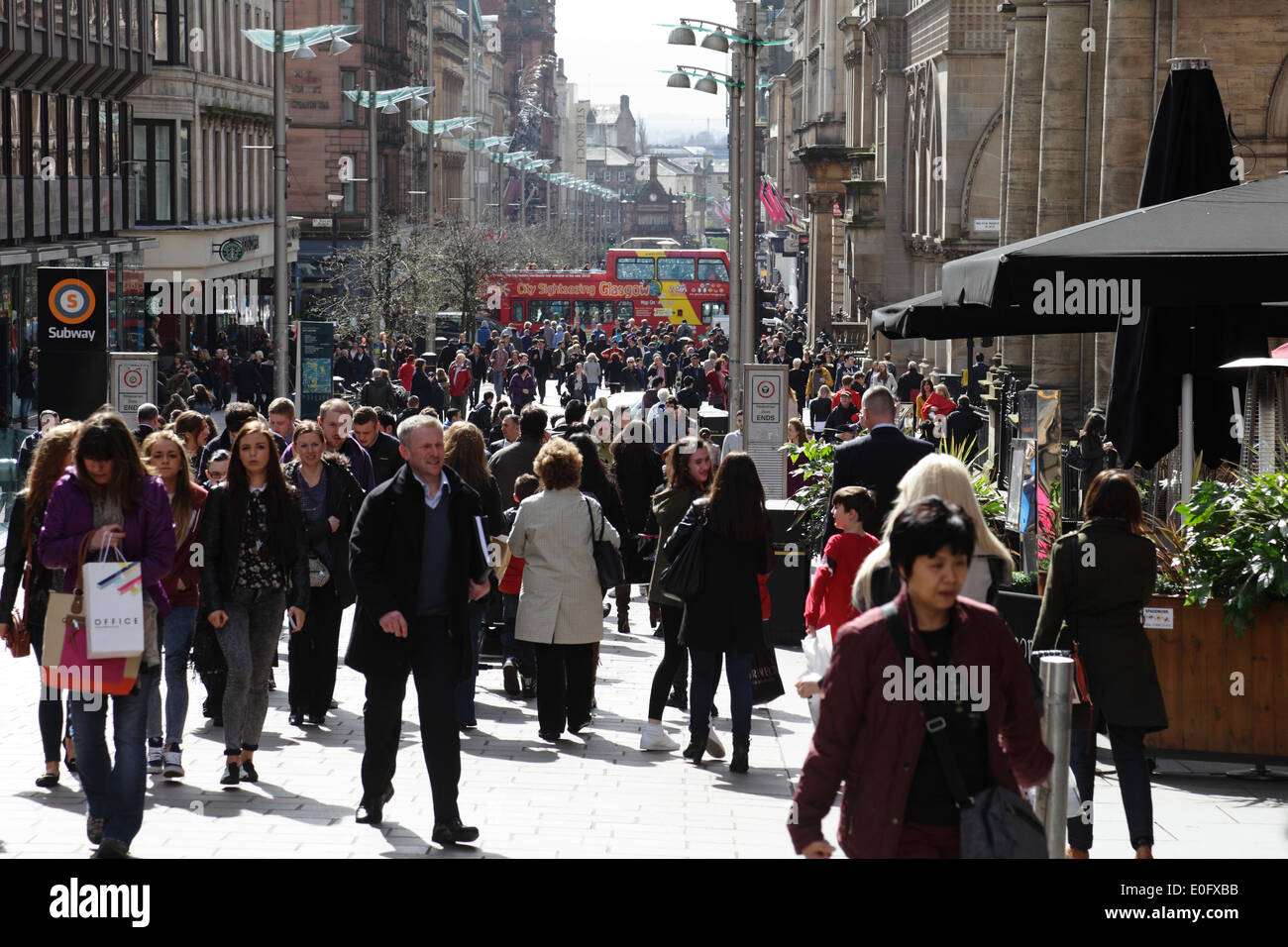 View south to people walking on Buchanan Street in Glasgow city centre, Scotland, UK - Stock Image