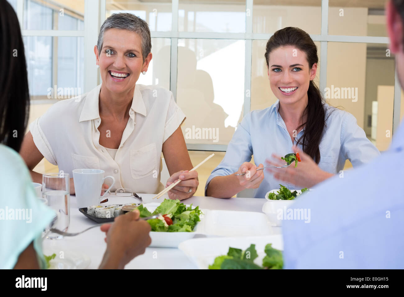 Business people enjoy healthy lunch - Stock Image