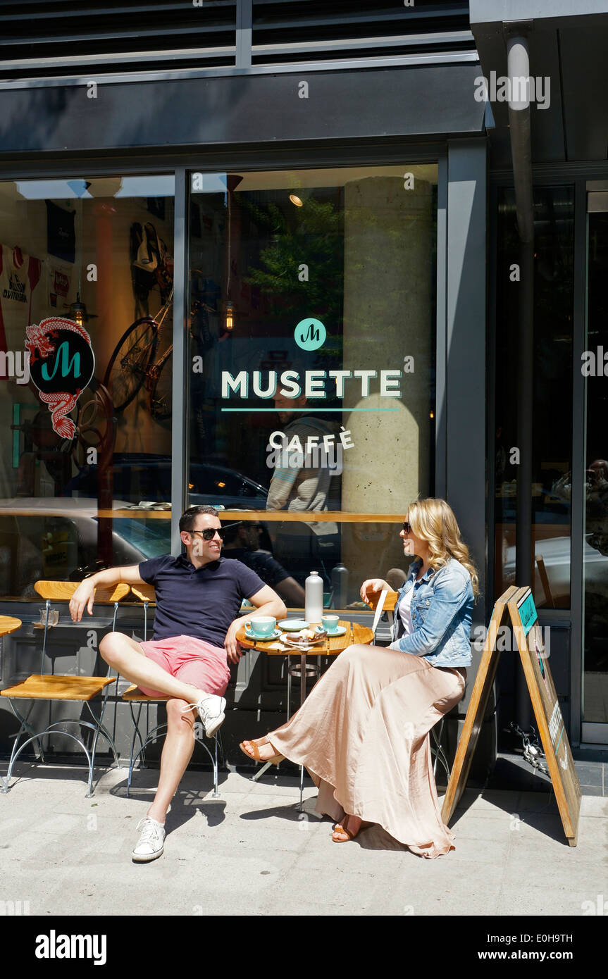 man-and-woman-sitting-outside-the-musett