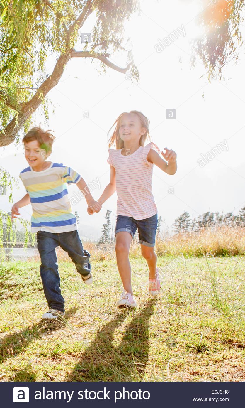 Children Having Fun In Countryside - Stock Image