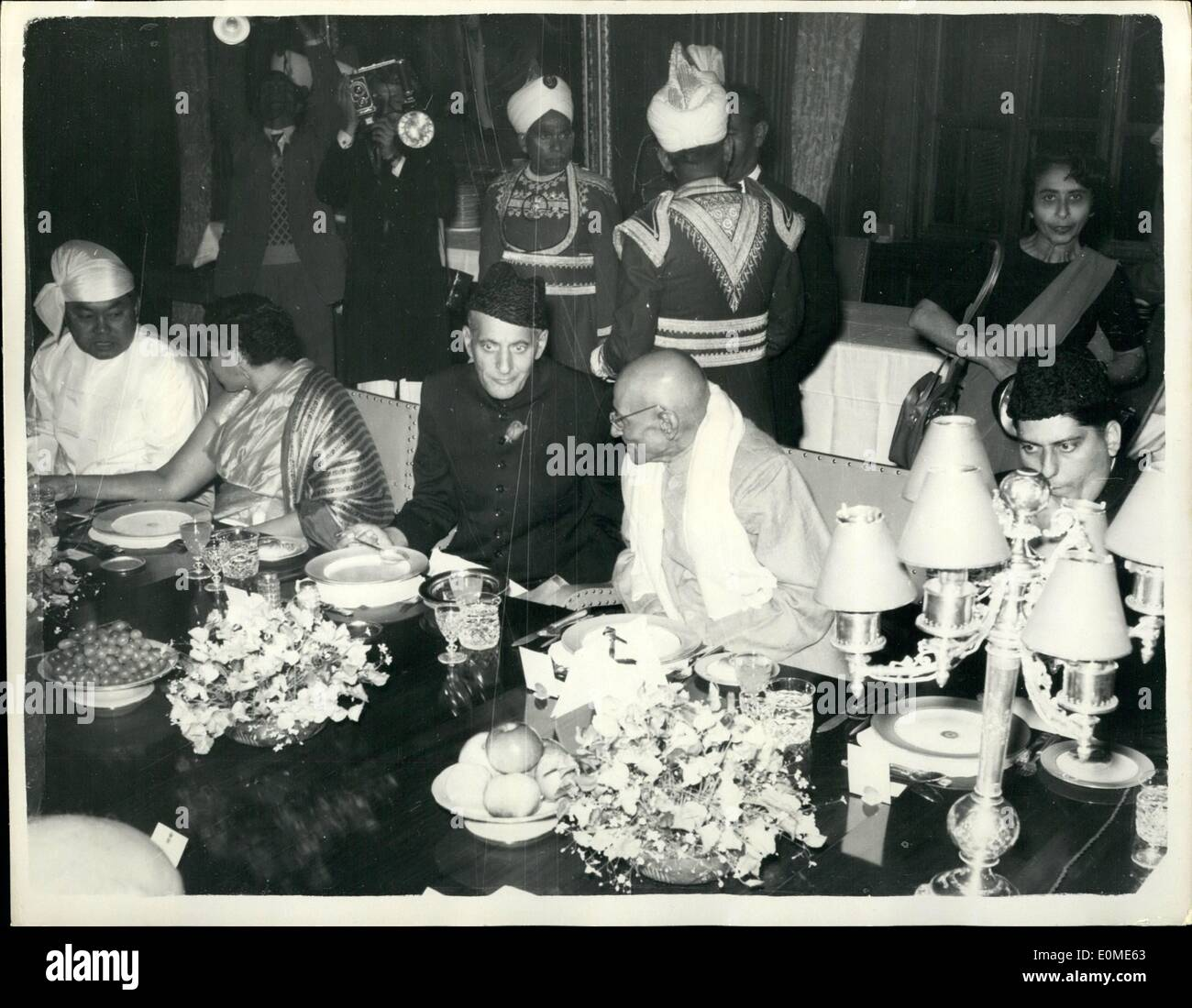 Jan. 01, 1955 - Governor General of Pakistan Attends Indian Republic Anniversary Ceremonies.. Mr. Ghulam Mohammad the Governor General of Pakistan was invited to attend the celebration in Delhi of the sixth anniversary of the Indian Republic.. Keystone Photo Shows:- Mr. Ghulam Mohammad at the State Banquet held in his honour at the President's House in Delhi. He is seen talking to C. Rajagopalachari, Governor of Madras. - Stock Image