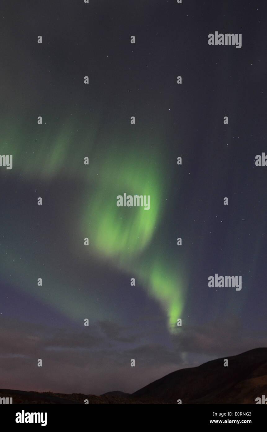 Aurora Borealis or Northern Lights above the Northern Lights Inn, near Grindavik, iceland - Stock Image