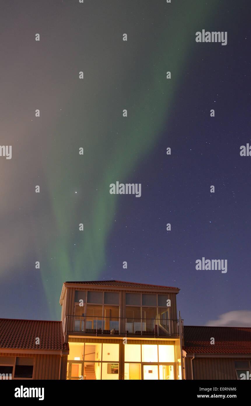 Aurora above the Northern Lights Inn, near Grindavik, iceland - Stock Image