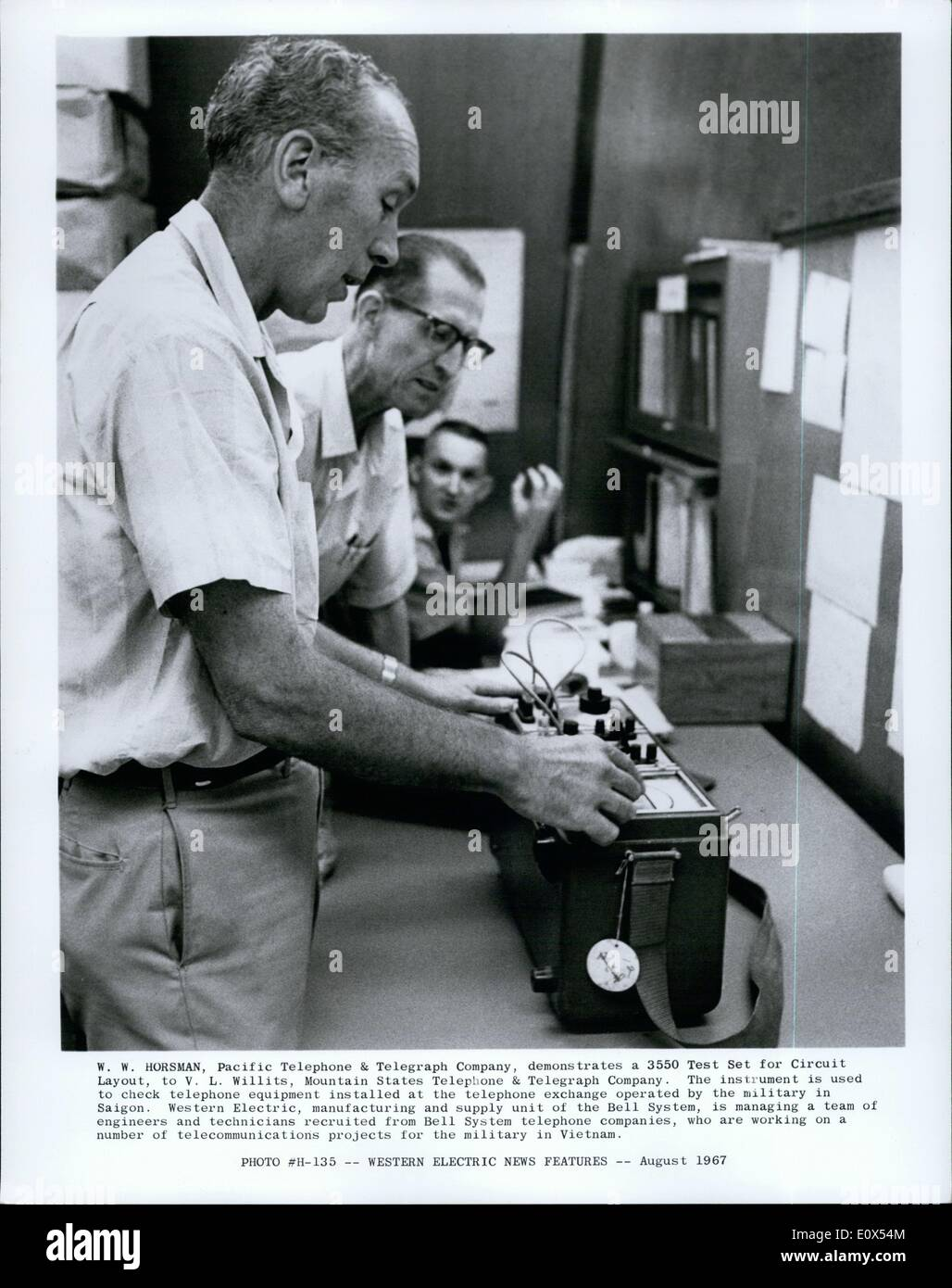 Jun 01, 1965 - W.N. Horsman Pacific Telephone & Telegraph Company, demonstrates a 3550 Test Set for Circuit - Stock Image