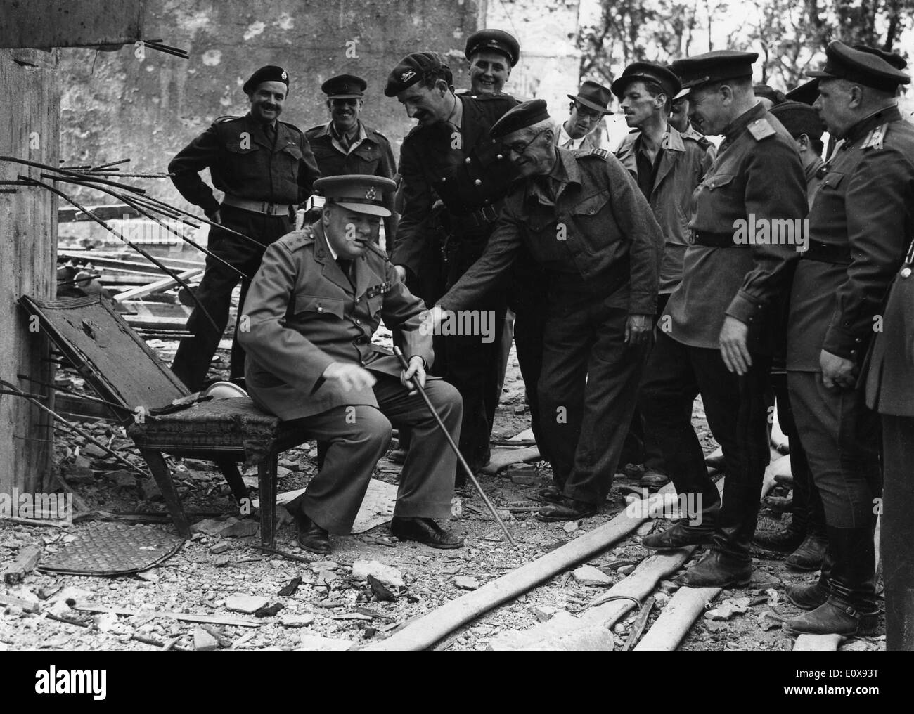 Sir Winston Churchill sits in Hitler's destroyed chair - Stock Image