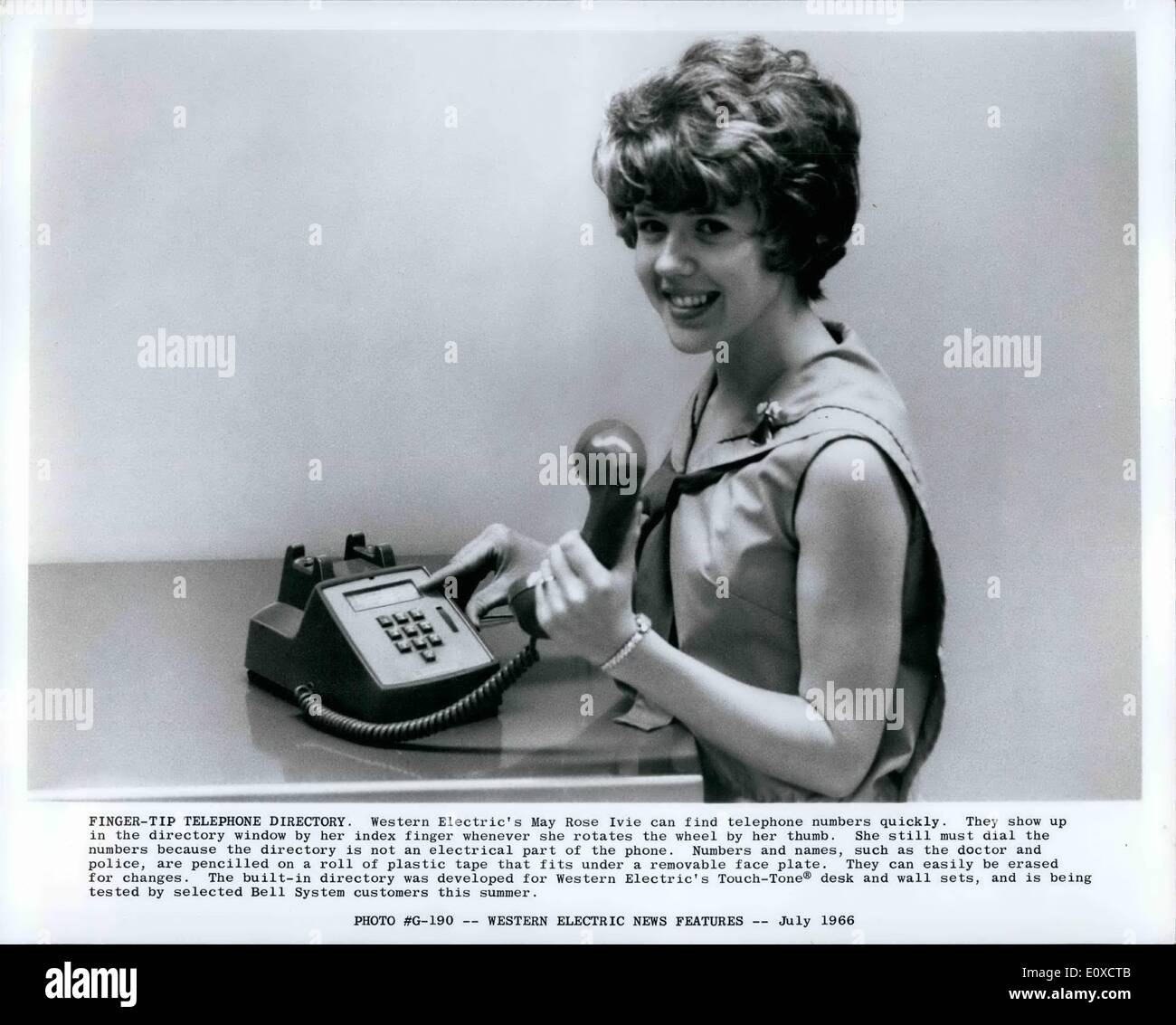 Jun. 06, 1966 - Finger-Tip Telephone Directory. Western Electric May Rose Ivie can find telephone numbers quickly. - Stock Image