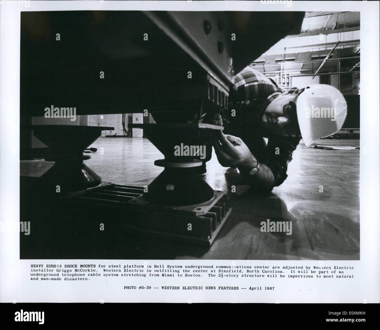 Apr. 04, 1967 - Heavy rubber shock mounts for steel platform in Bell System underground communication center are - Stock Image
