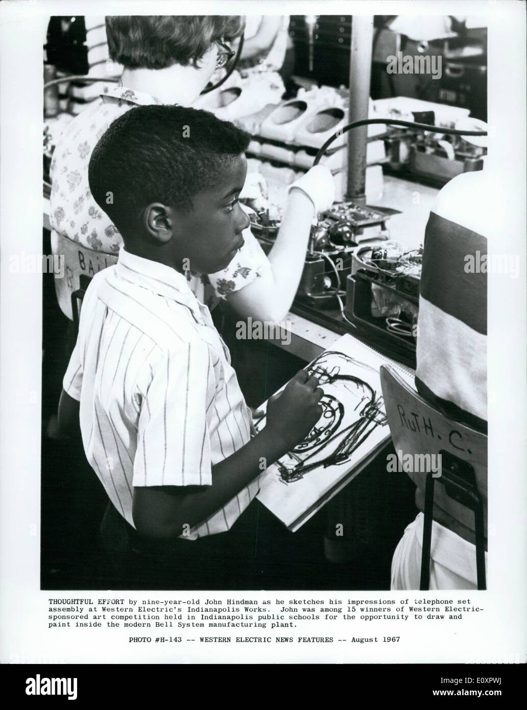 Aug. 08, 1967 - Thoughtful Effort by nine-year-old John Hind-man as he sketches his impression of telephone set - Stock Image