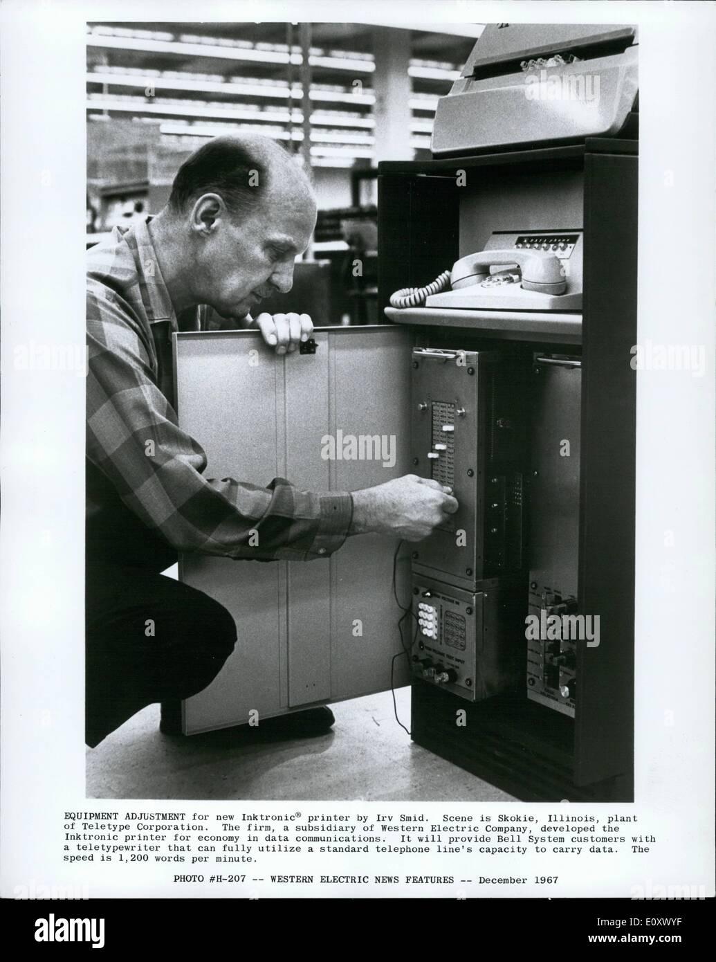 Dec. 12, 1967 - Equipment adjustment for new Inktronic printer by Irv Smid. Scene is Skokie, Illinois, plant of - Stock Image