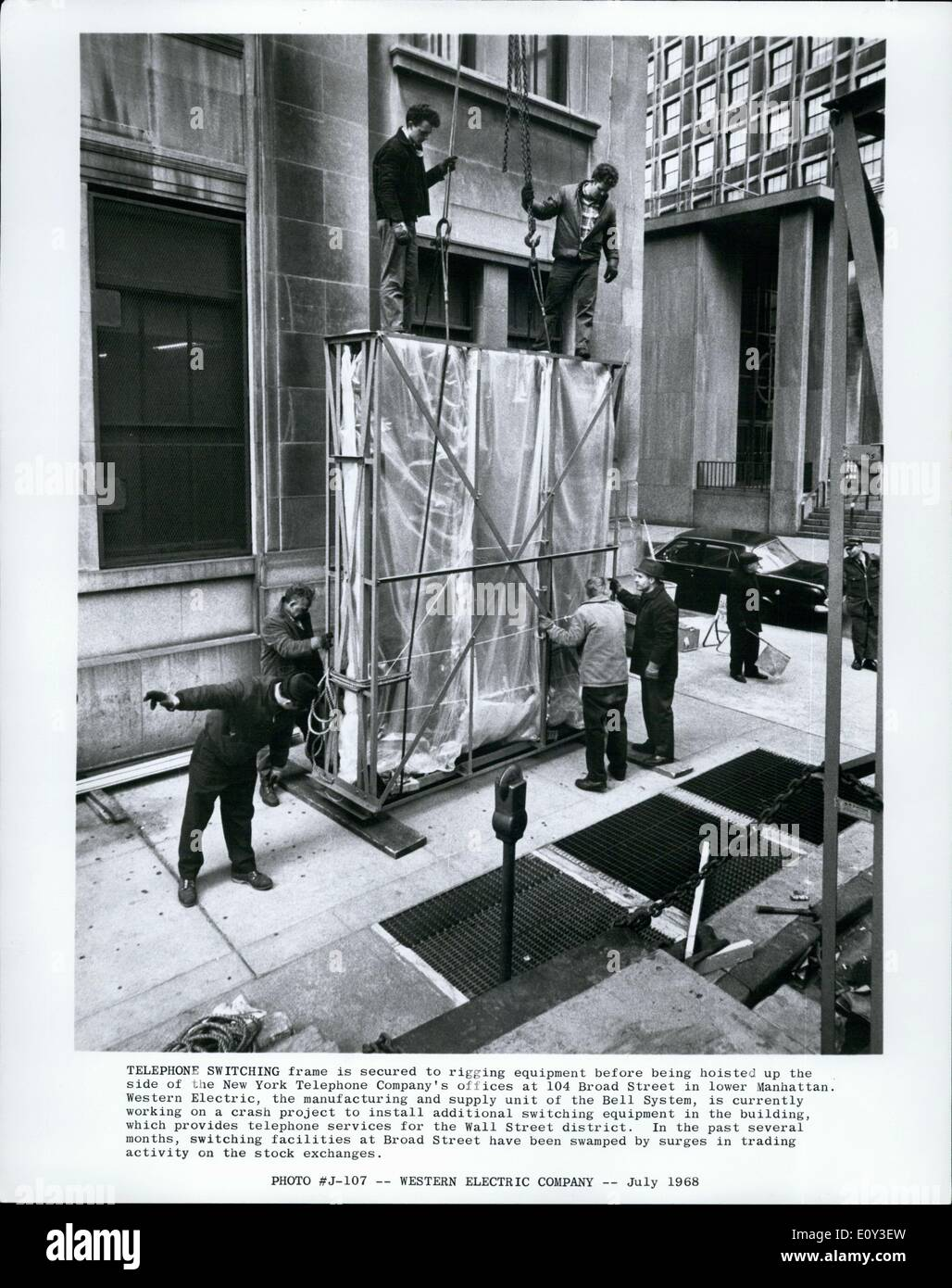 Jul. 07, 1968 - Telephone Switching frame is secured to rigging equipment before being hoisted up the side of the - Stock Image