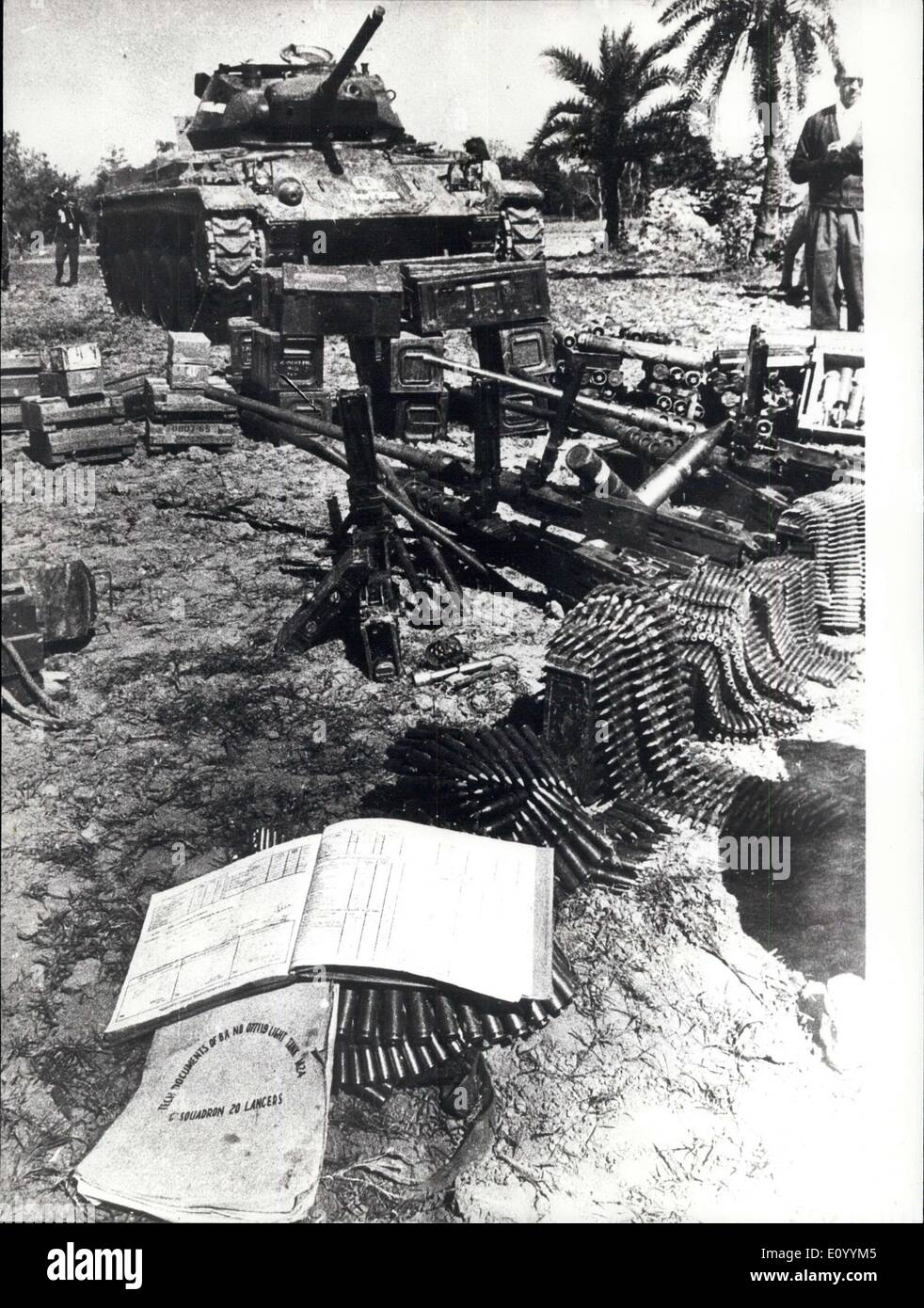 Dec. 07, 1971 - December 7th, 1971 Left behind by Pakistan troops - A huge quantity of araa and ammunition left behind by fleeing Pakistani troops at Garihpur in Bangla Desh after an encounter with the Indian defenoe forces recently. In the foreground are documents seized by Indian troopa fron the damaged and captured tanka that show that the Pakistani troops belonged to C Squadron of 20 lanoers regiment of Pakistan. - Stock Image