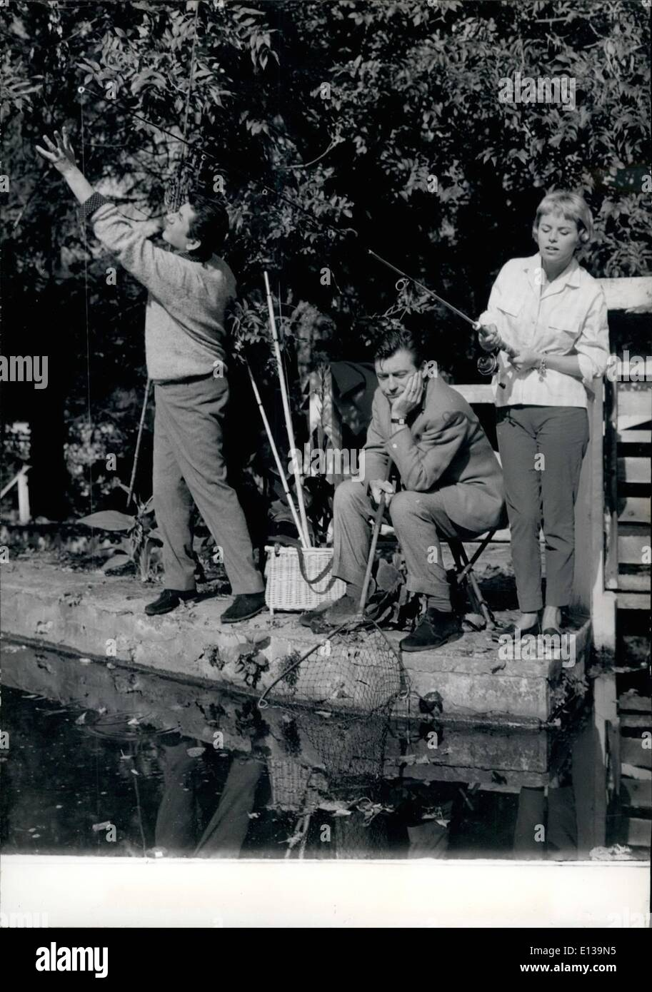 Feb. 29, 2012 - SCREEN STARS GO ANGLING DANIEL GELIN, FRANCOIS PERIER AND GENEVIEVE CLUNY (FROM LEFT TO RIGHT) ANGLING - Stock Image