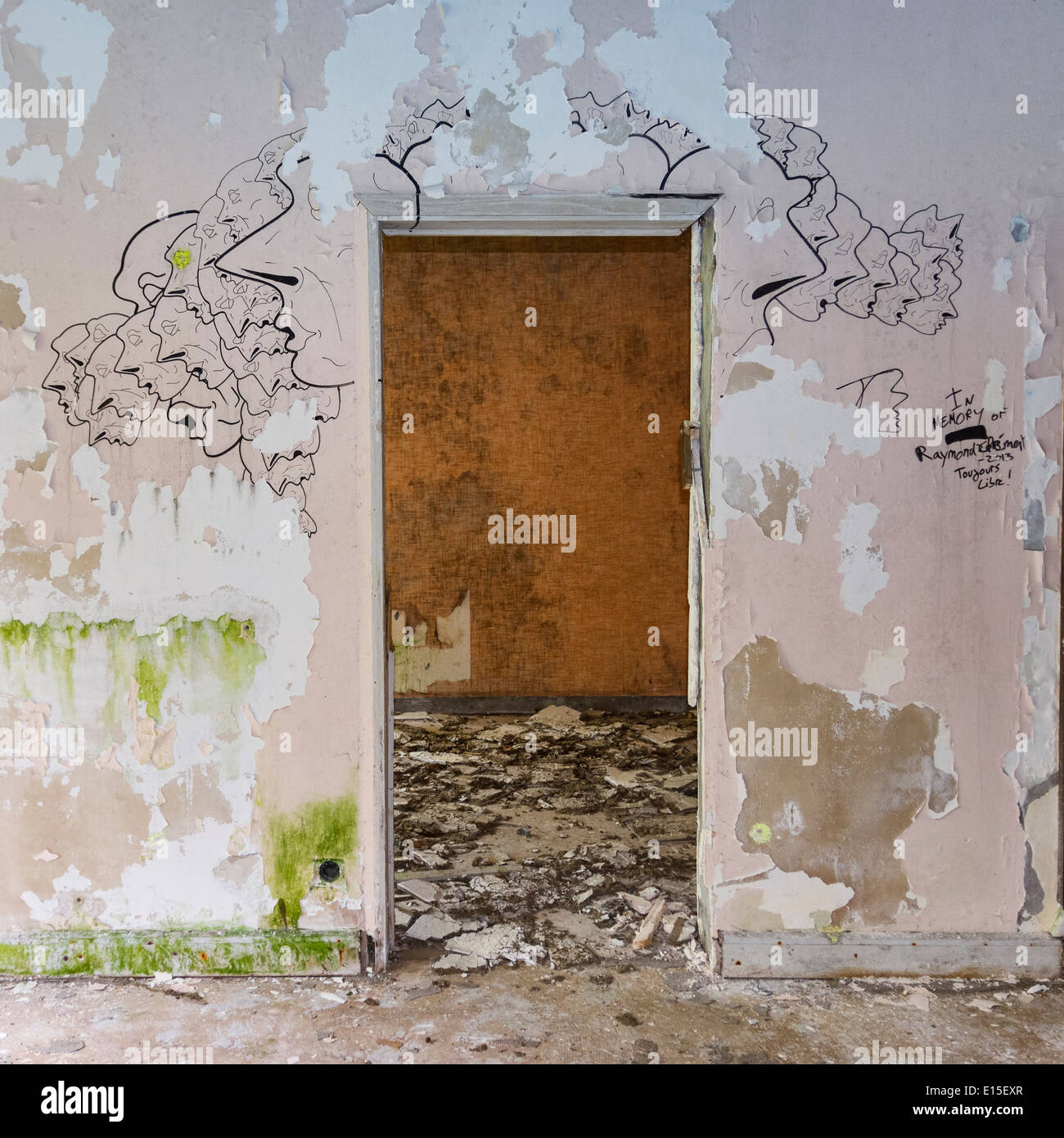 Portugal, Azores, San Miguel, doorframe and drawings on wall in empty hotel ruin - Stock Image