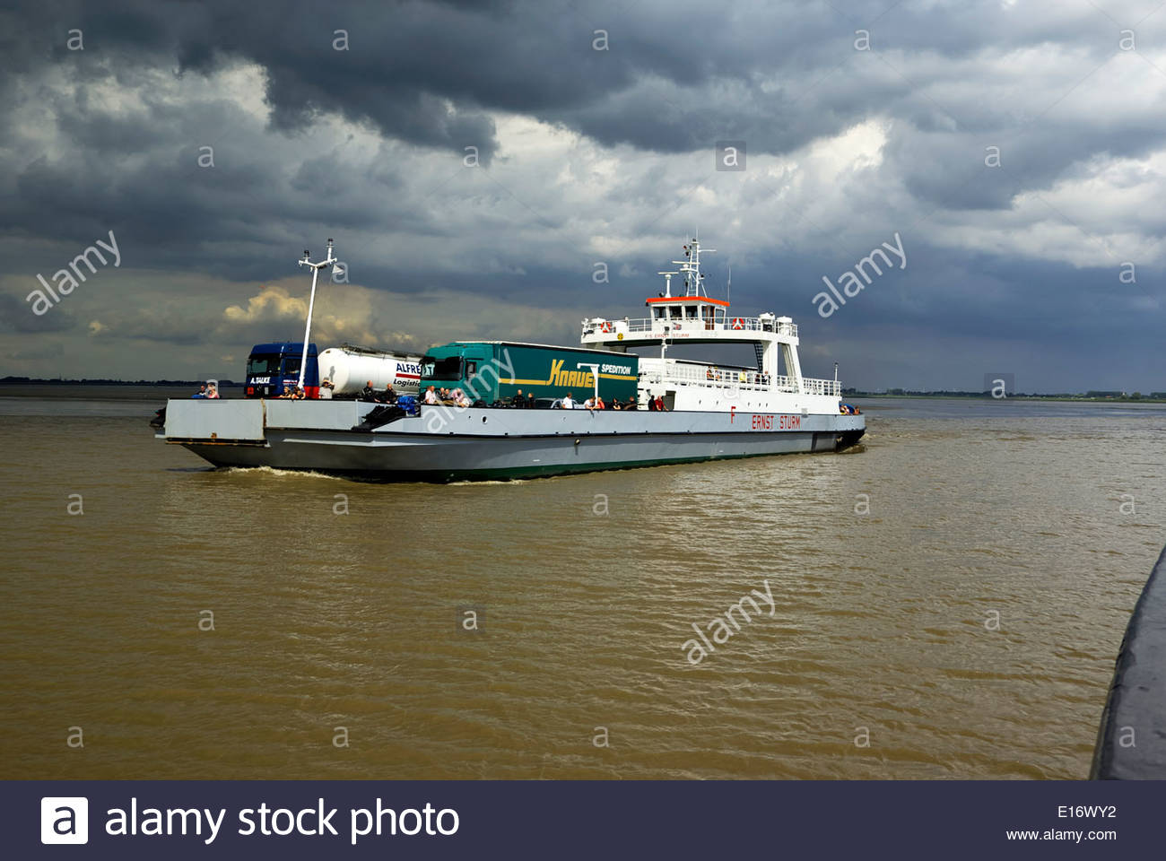 The ferry Ernst Sturm crosses the Elbe River north of Hamburg, from Wischhafen to Glückstadt, carrying vehicles Stock Photo