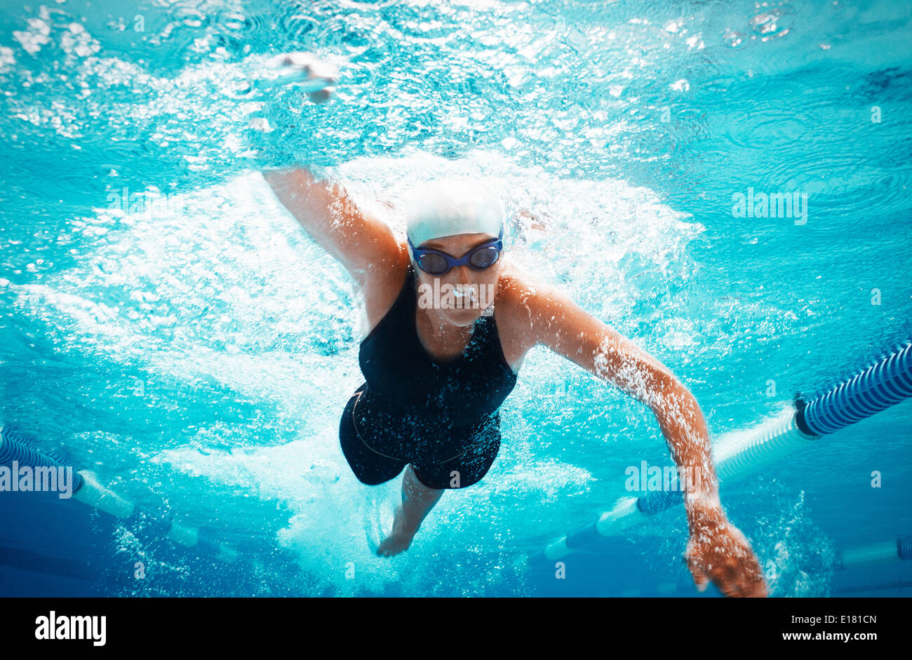 Swimmer racing in pool - Stock Image
