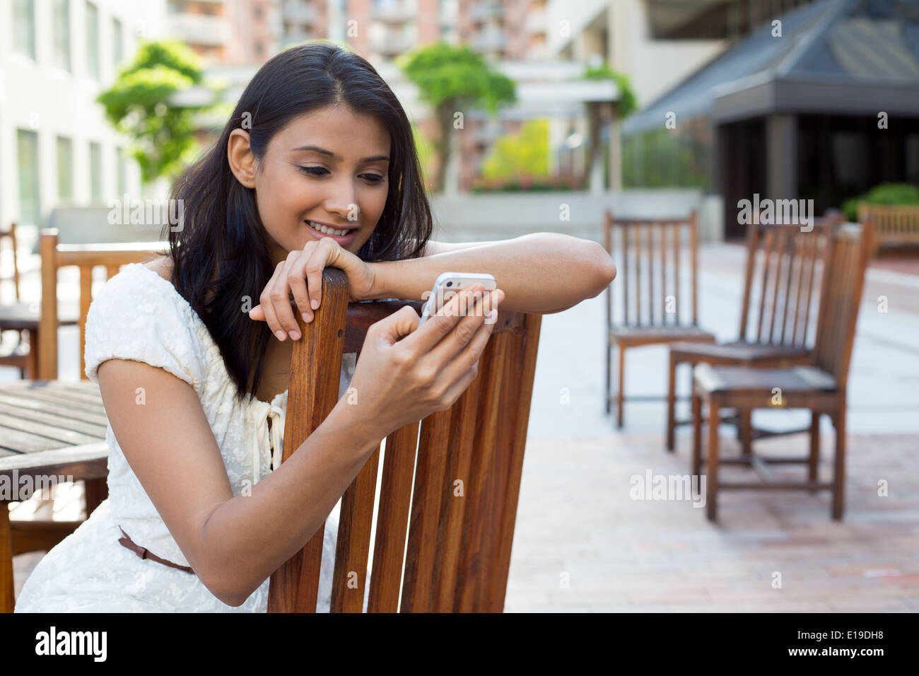 Perusing texts or emails - Stock Image