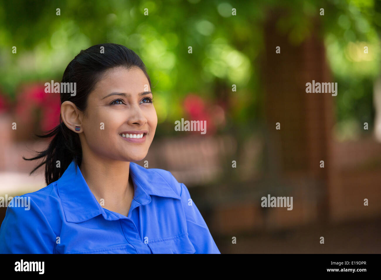 Daydreaming in park - Stock Image