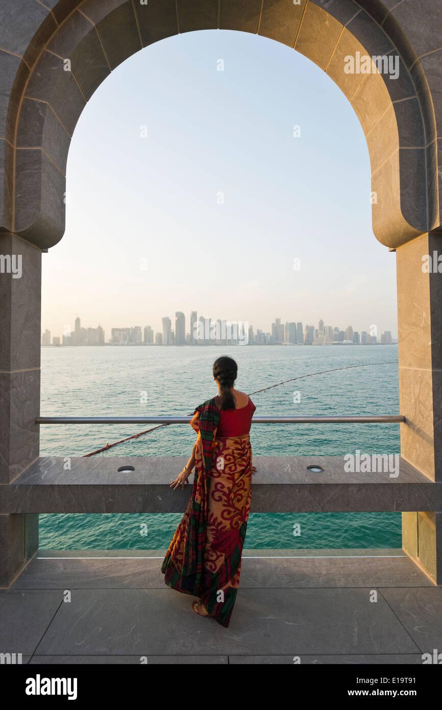 Doha. Qatar. Vistitor looking across Bay of Doha from the Museum of Islamic Art. - Stock Image