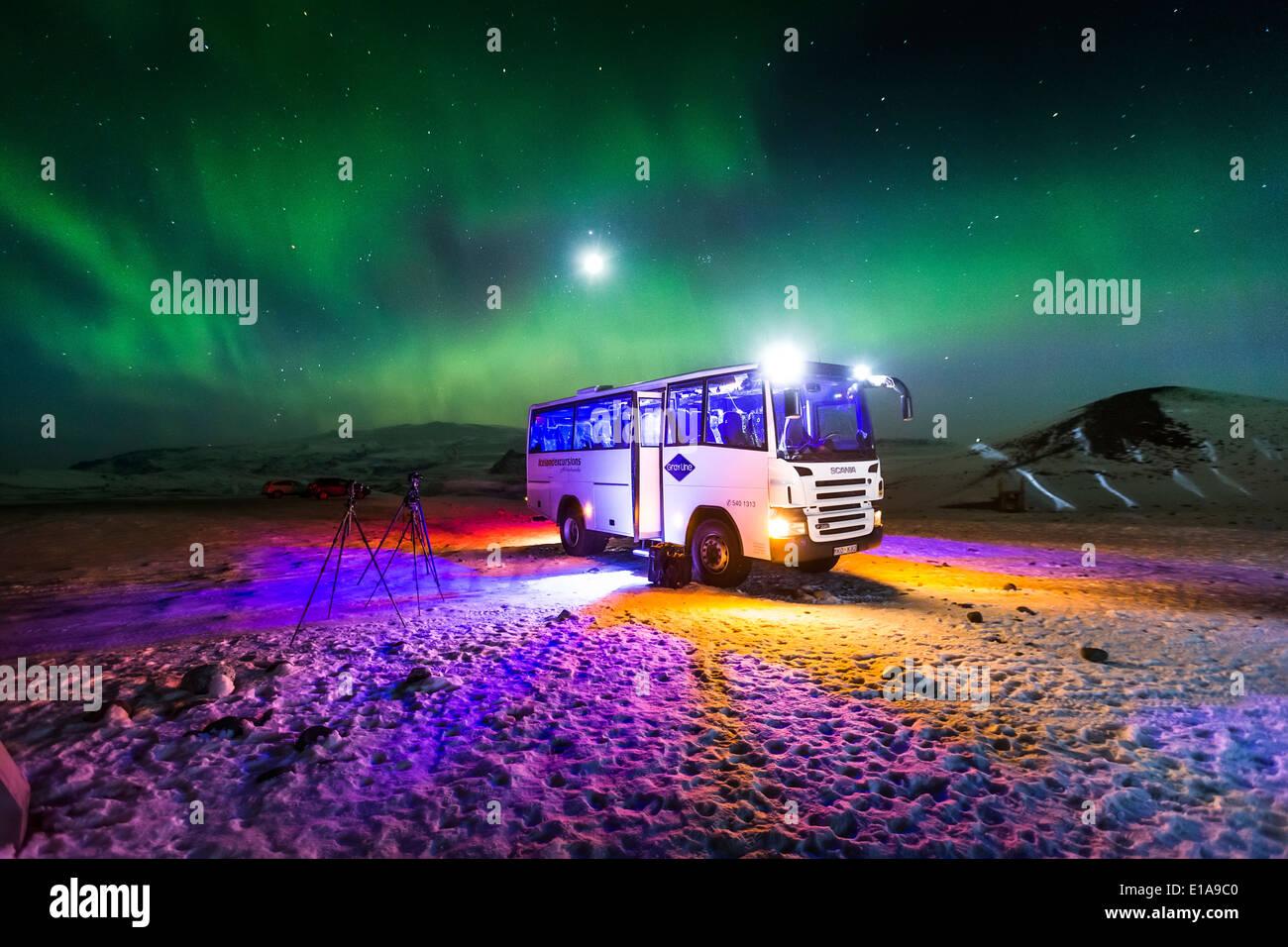 Aurora Borealis Or Northern Lights, Iceland Tour Bus At The Jokulsarlon,  Breidamerkurjokull, Vatnajokull Ice Cap, Iceland