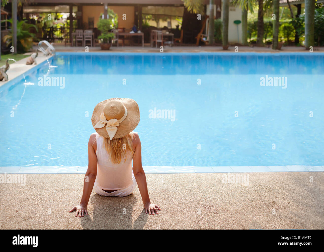enjoy vacations in luxury hotel with swimming pool - Stock Image
