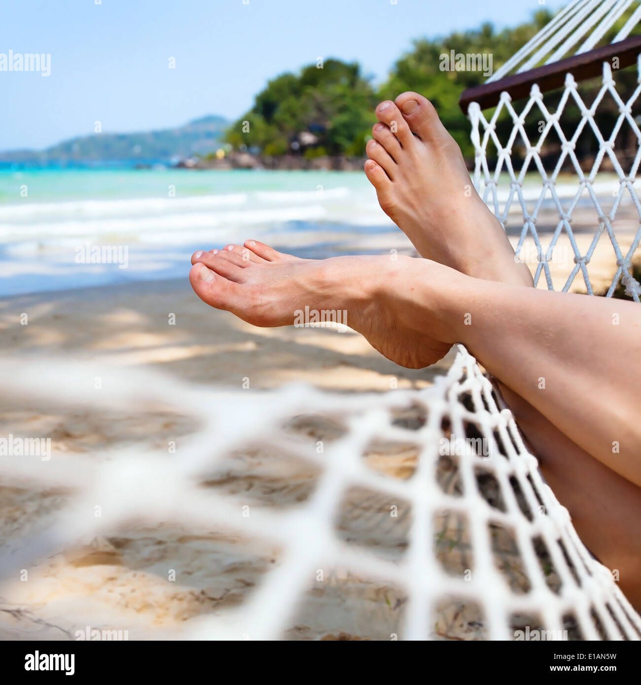 relax in hammock on the beach - Stock Image
