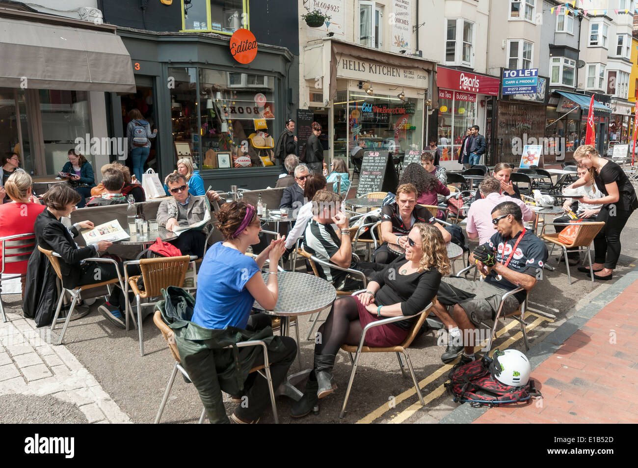 People Enjoy Food and Drinks at Outdoor Pubs and Cafés in North Laine Area of Brighton, England, UK Stock Photo