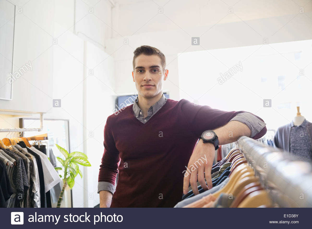 Portrait of business owner in clothing shop - Stock Image