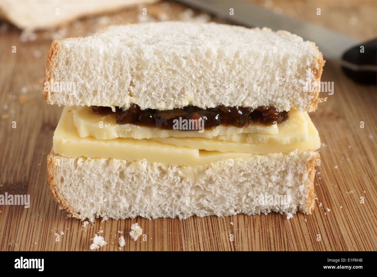 Rustic style hand cut Cheddar cheese and pickle sandwich made with crusty home made bread Stock Photo