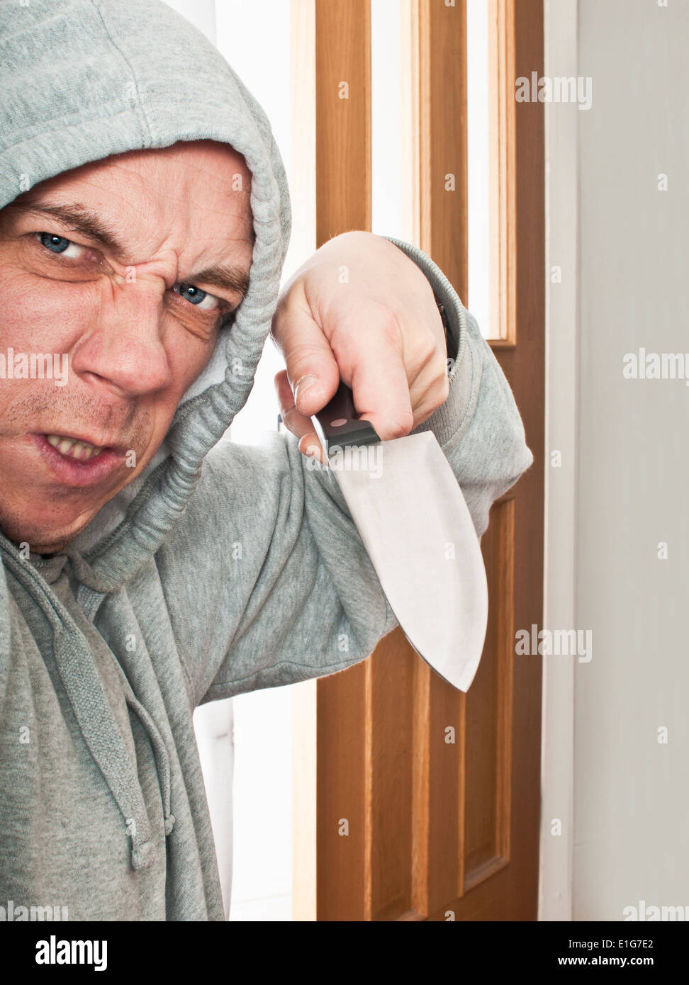 Violent man with a knife - Stock Image