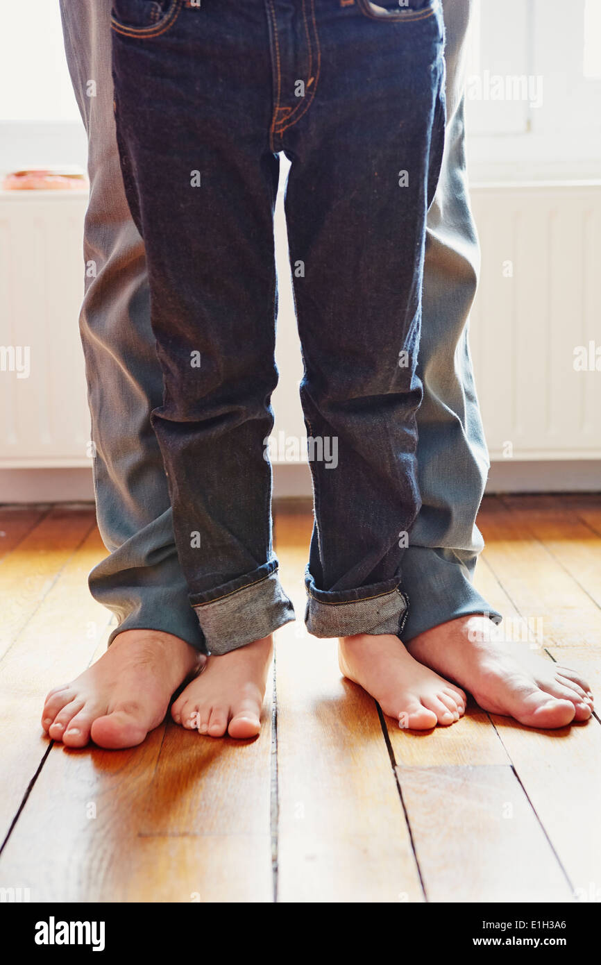 Father and son playing games with feet - Stock Image
