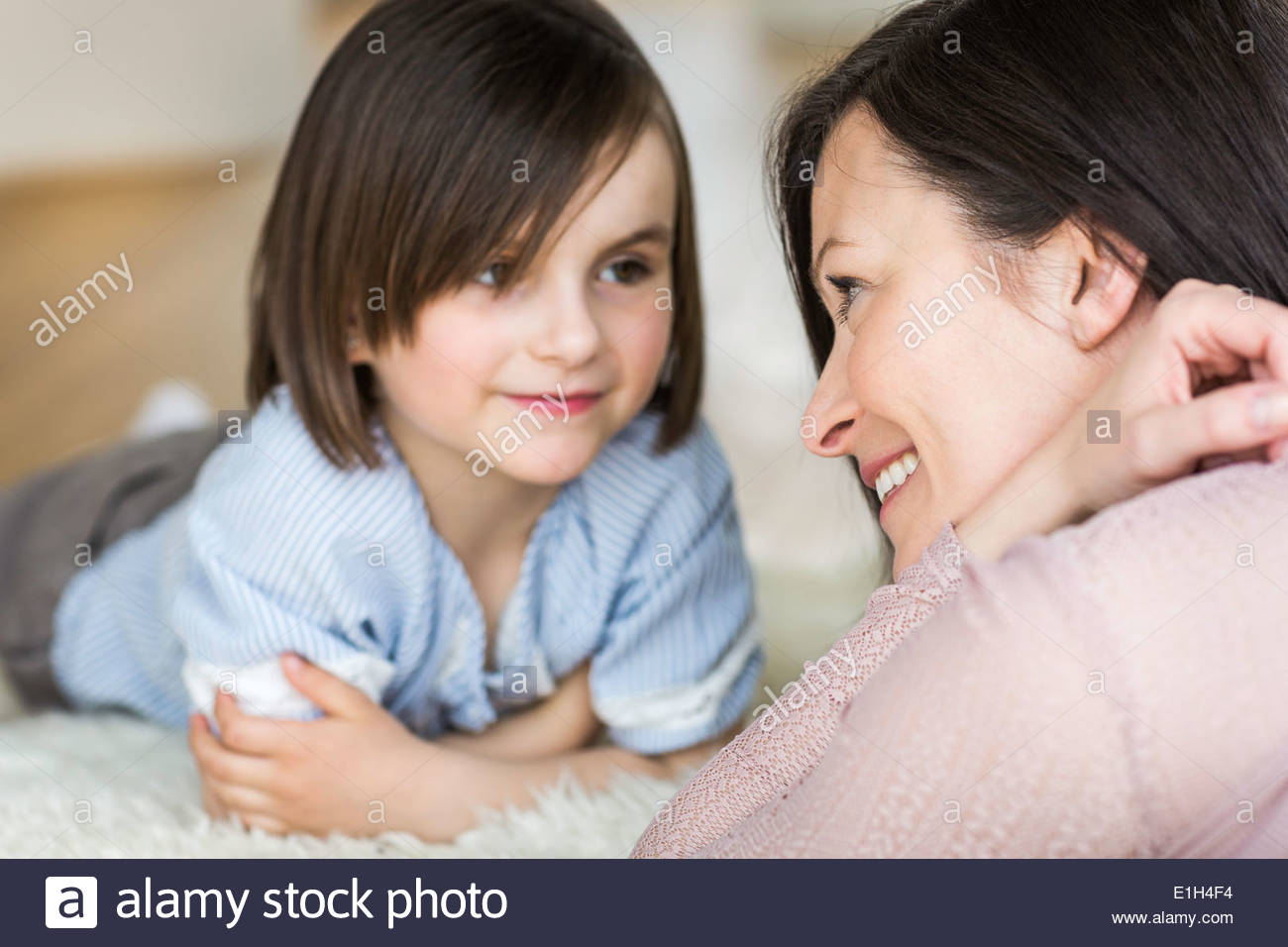 Mother and daughter face to face - Stock Image