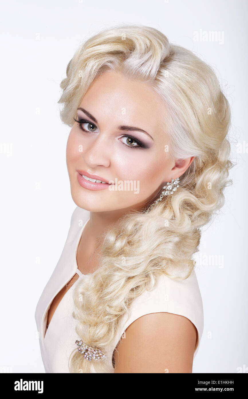 Sophisticated Classy Blond with Silver Earrings - Stock Image