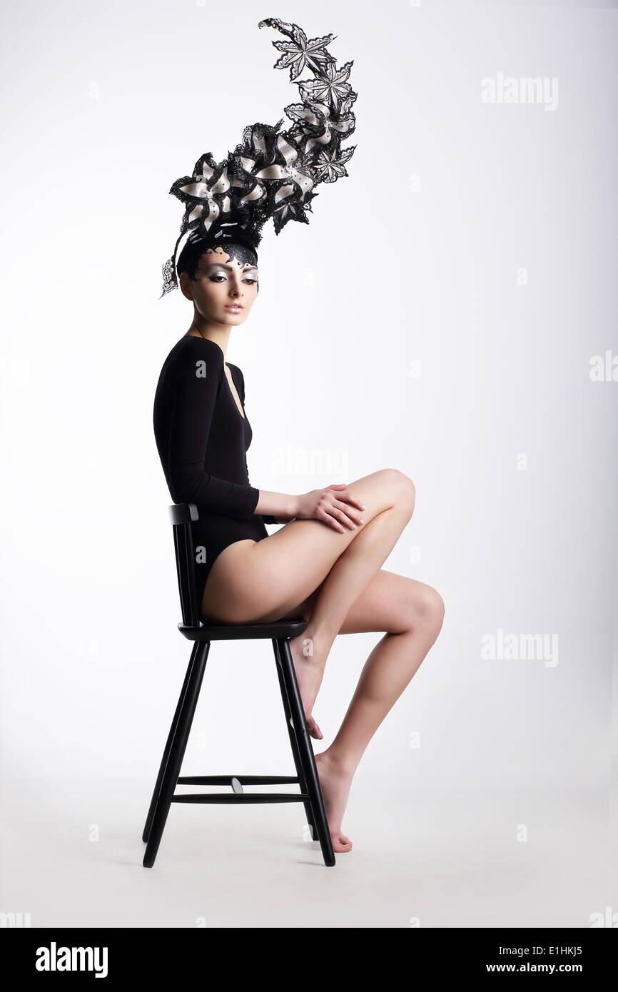 Extravagance. Glamorous Woman in Surreal Metallic Headwear - Stock Image