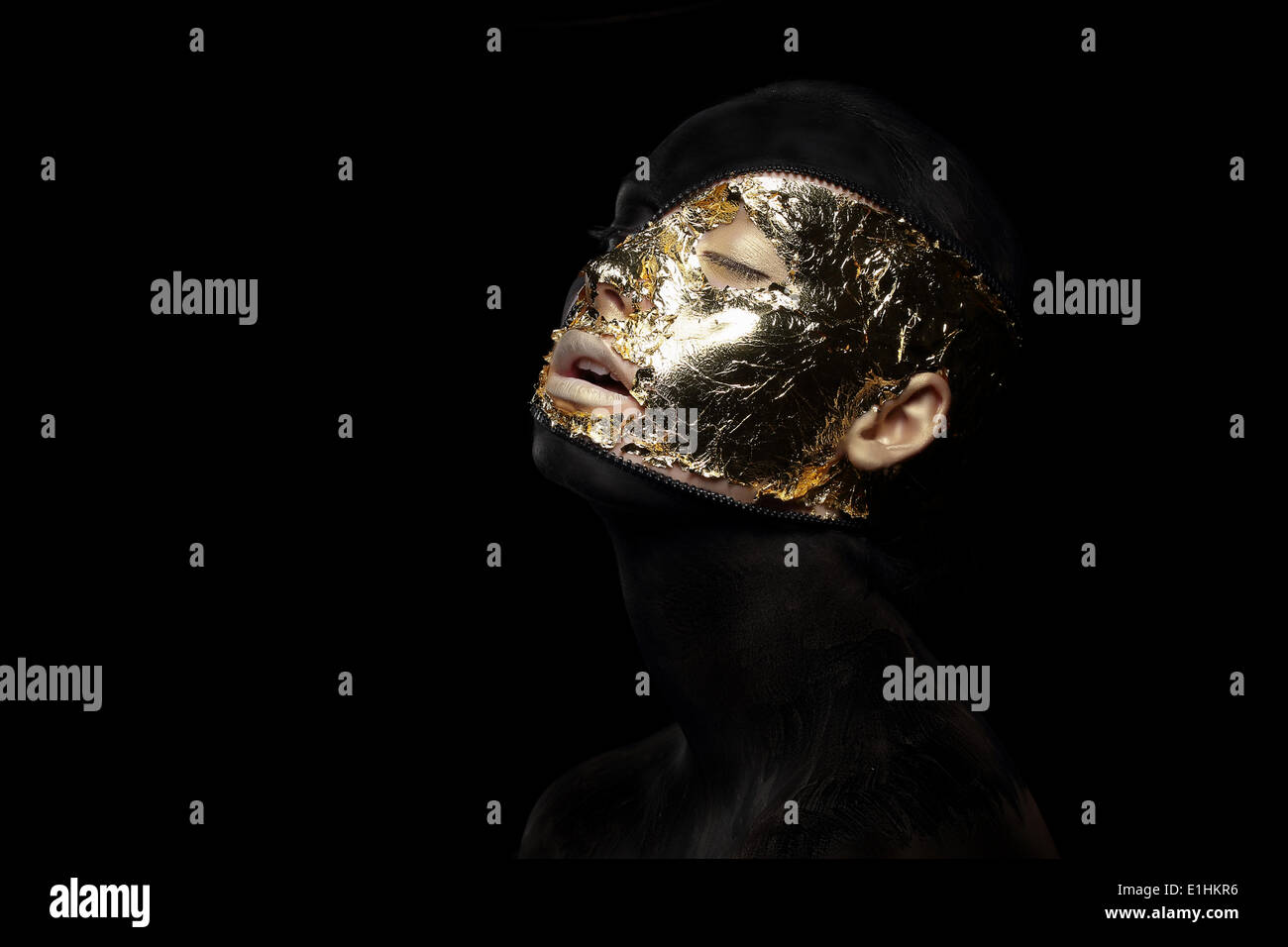Fiction. Imagination. Futuristic Creature in Crazy Mystic Mask and Gilt - Stock Image