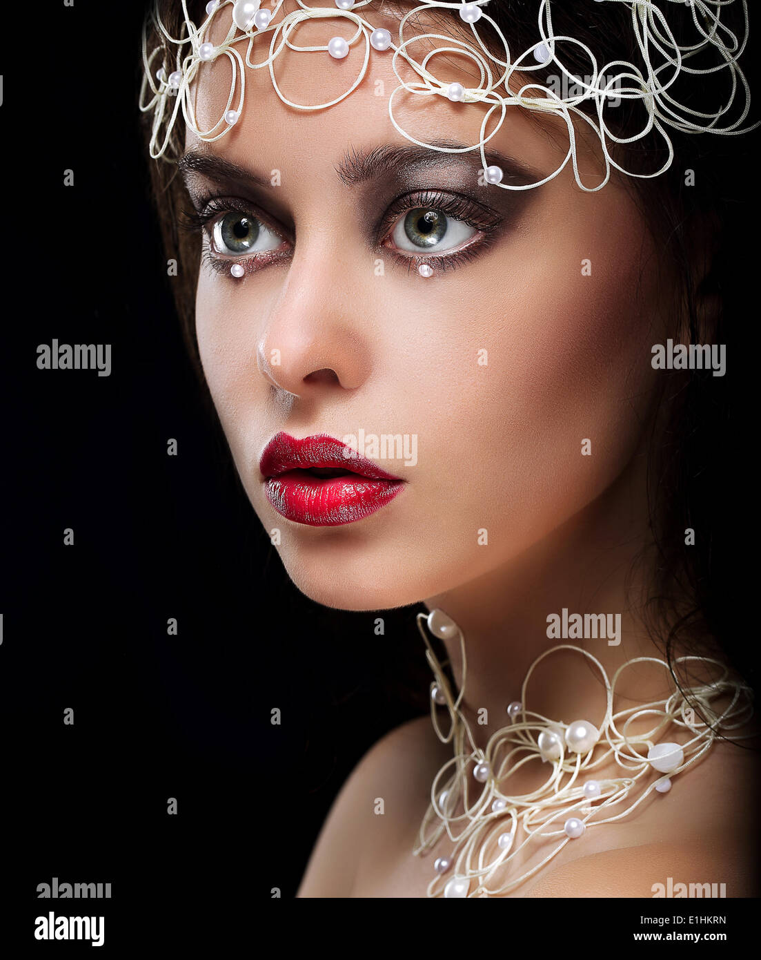 Decoration. Portrait of Gorgeous Woman with Pearls and Beads - Stock Image