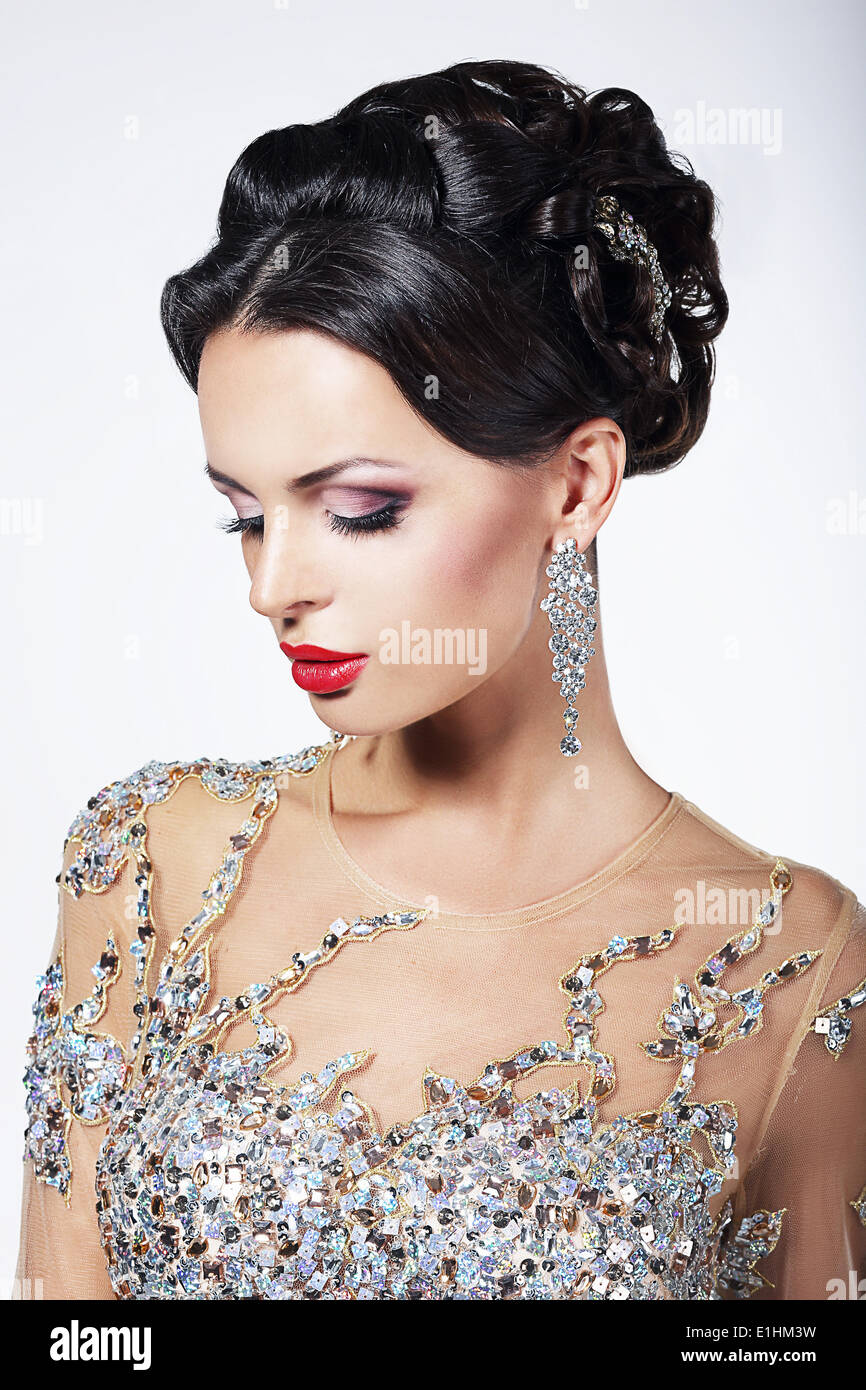 Formal Party. Gorgeous Fashion Model in Ceremonial Shiny Dress with Jewels - Stock Image