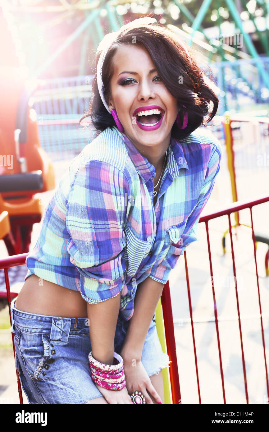 Enjoyment. Gladness. Expressive Woman in Checkered Shirt with Toothy Smile - Stock Image