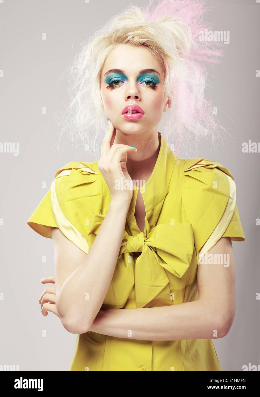 Art Deco. Vivid Blond Hair Woman with  Conspicuous Makeup. Glamor - Stock Image