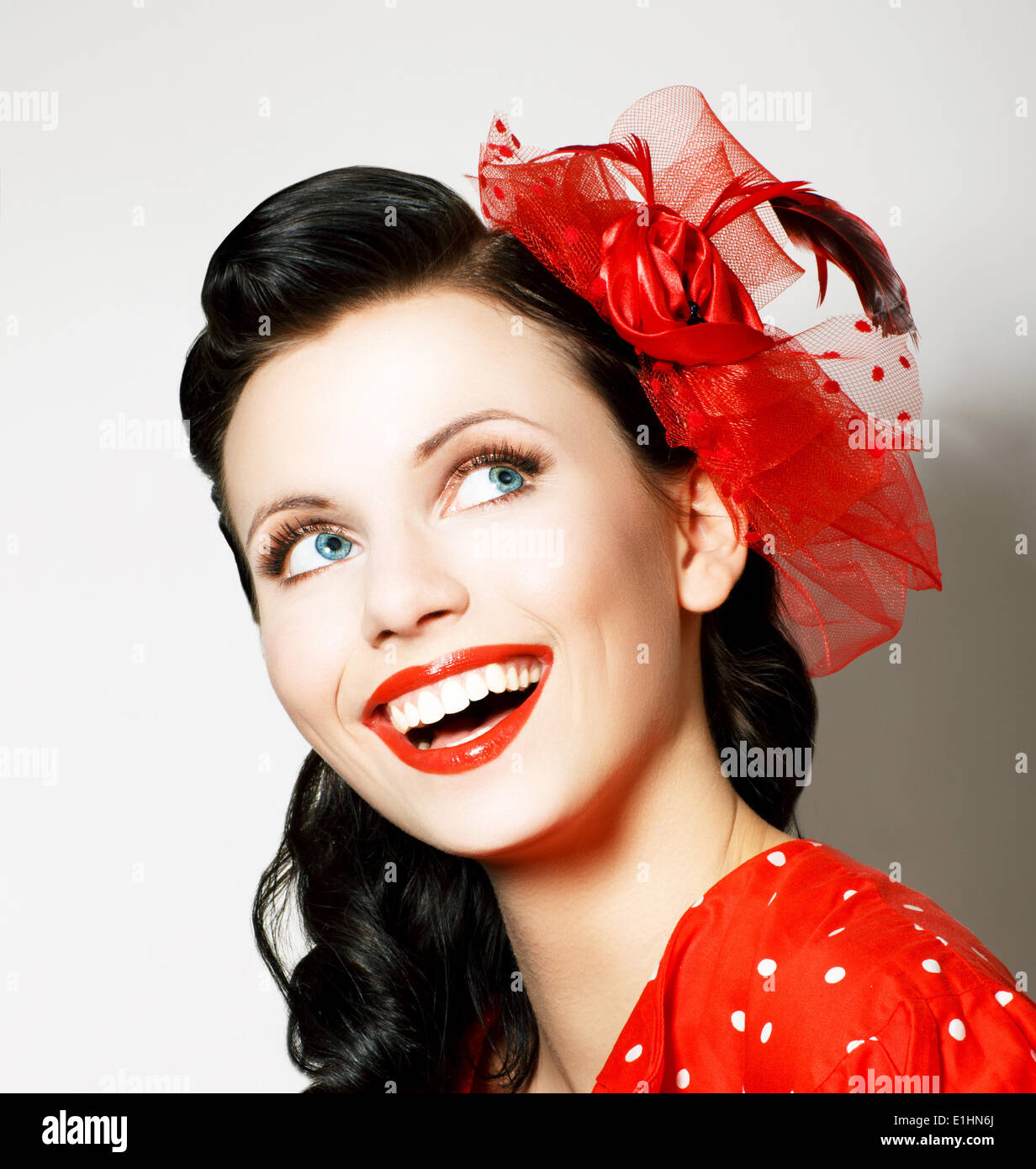 Vitality. Cheerful Young Woman with Red Bow enjoying. Pleasure - Stock Image
