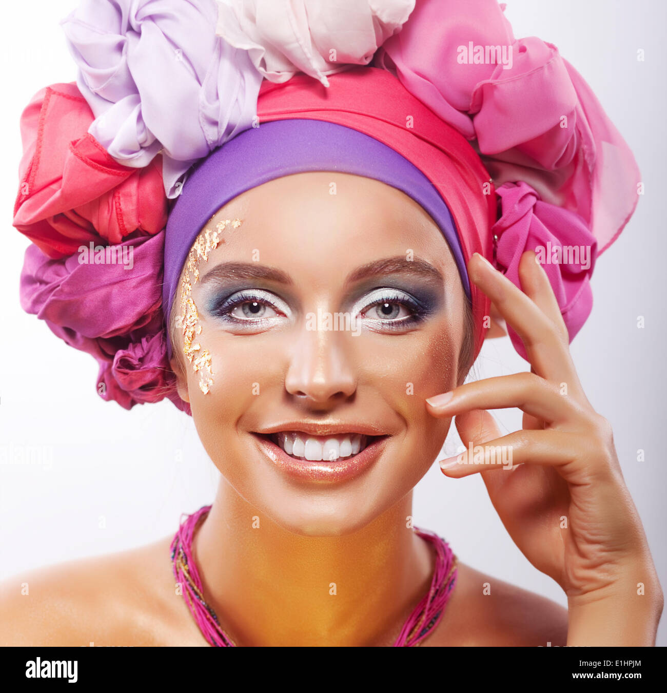 Lifestyle. Beauty. Portrait of young happy toothy smiling woman in colorful headwear - Stock Image