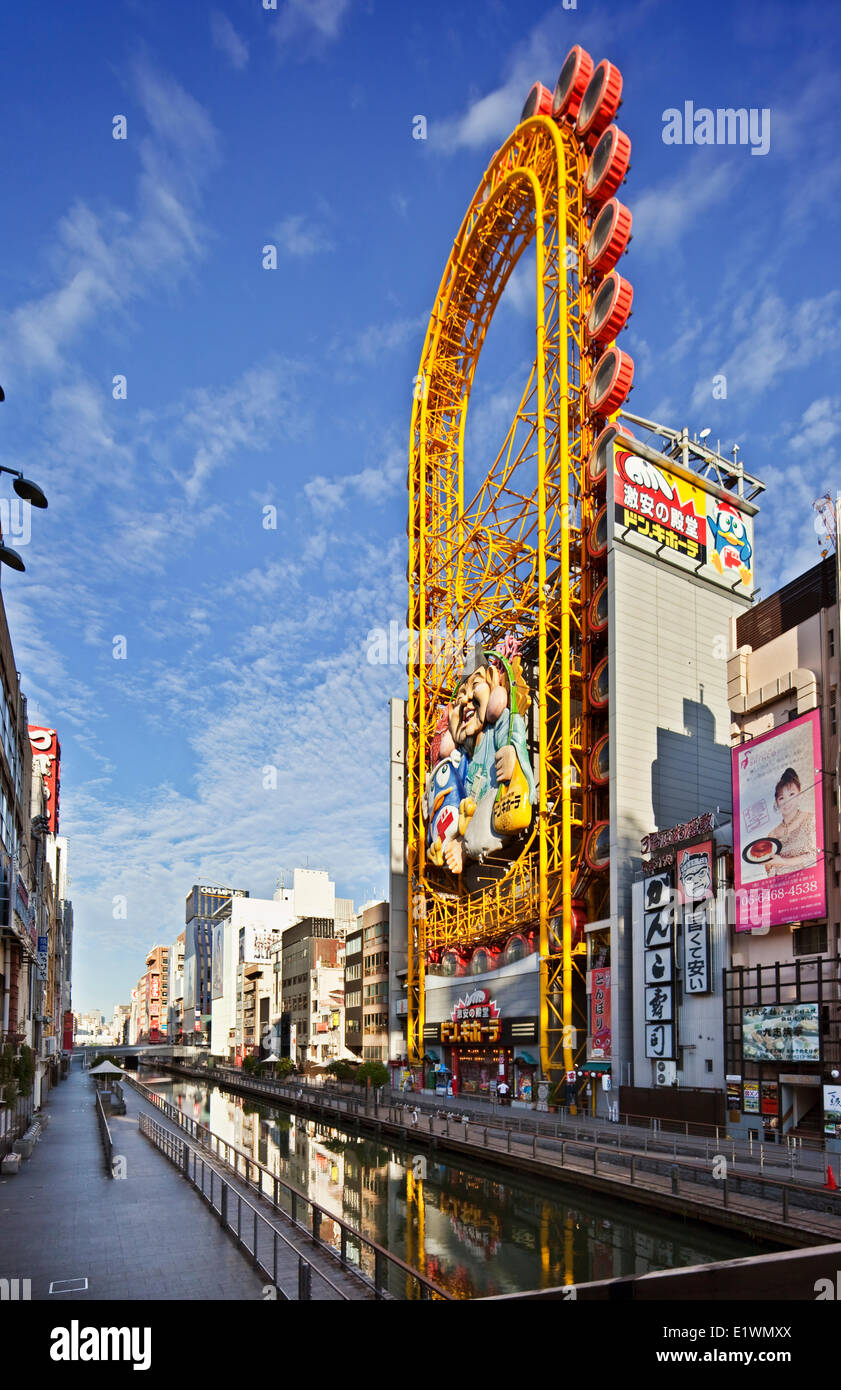Along the famous Dotombori canal in Osaka Japan are numerous restaurants cafes as well as a 4-story discount department - Stock Image