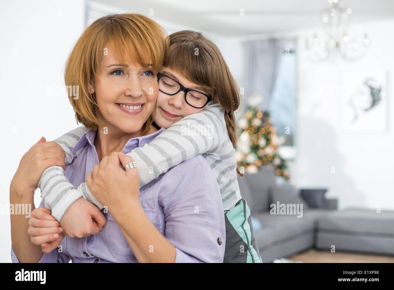 loving daughter embracing mother at home stock photo 70044388 alamy